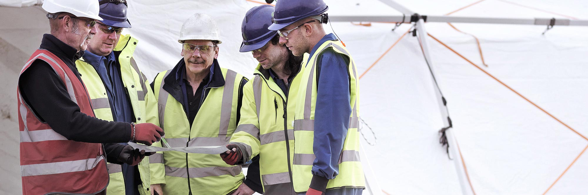 Workers reviewing plans
